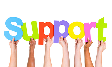hands holding up letters in the word Support