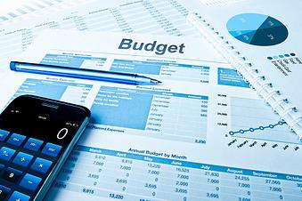 budget sheet, calculator and pen