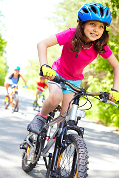 girl riding bike in homeowners association
