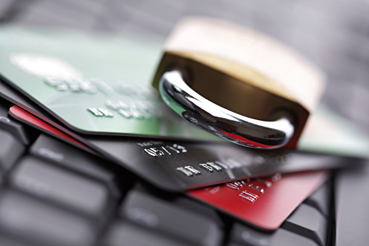 lock and credit cards on computer keyboard