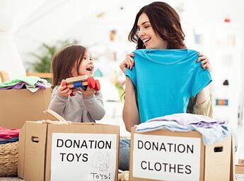 Mother and daughter with donation boxes