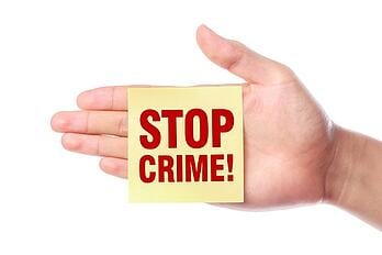 stop crime post-it note stuck to hand