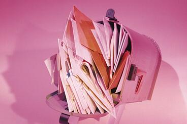 Junk_mail_overflowing_in_mailbox