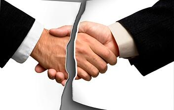 photo of handshake torn in two