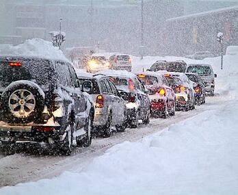 cars on snowy winter road