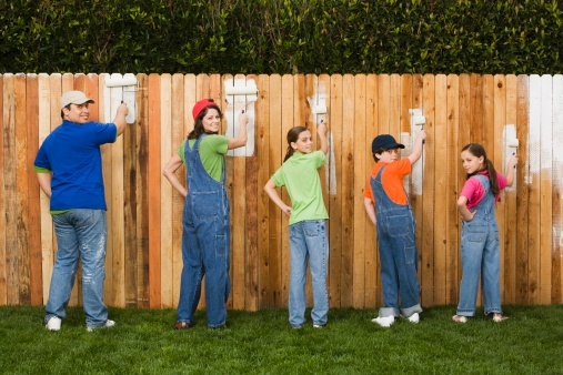 family_painting_fence