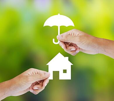 hands_holding_paper_umbrella_over_paper_house