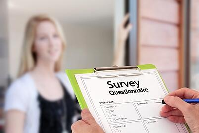 person at door with survey questionnaire