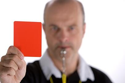 referee holding penalty card
