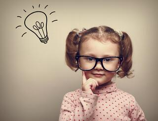 little girl thinking with light bulb above her head
