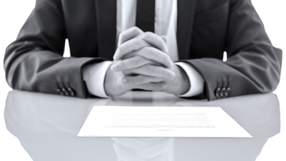 lawyer at desk with hands folded