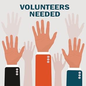volunteers needed with hands raised