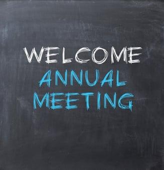 welcome annual meeting written on chalkboard