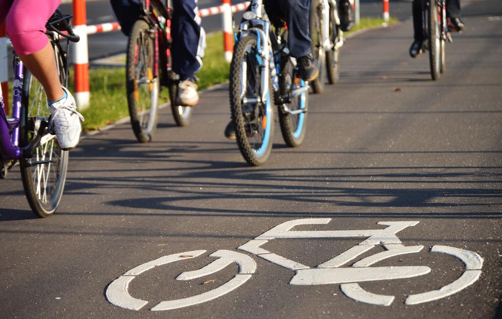 bikes and bike road sign on asphalt