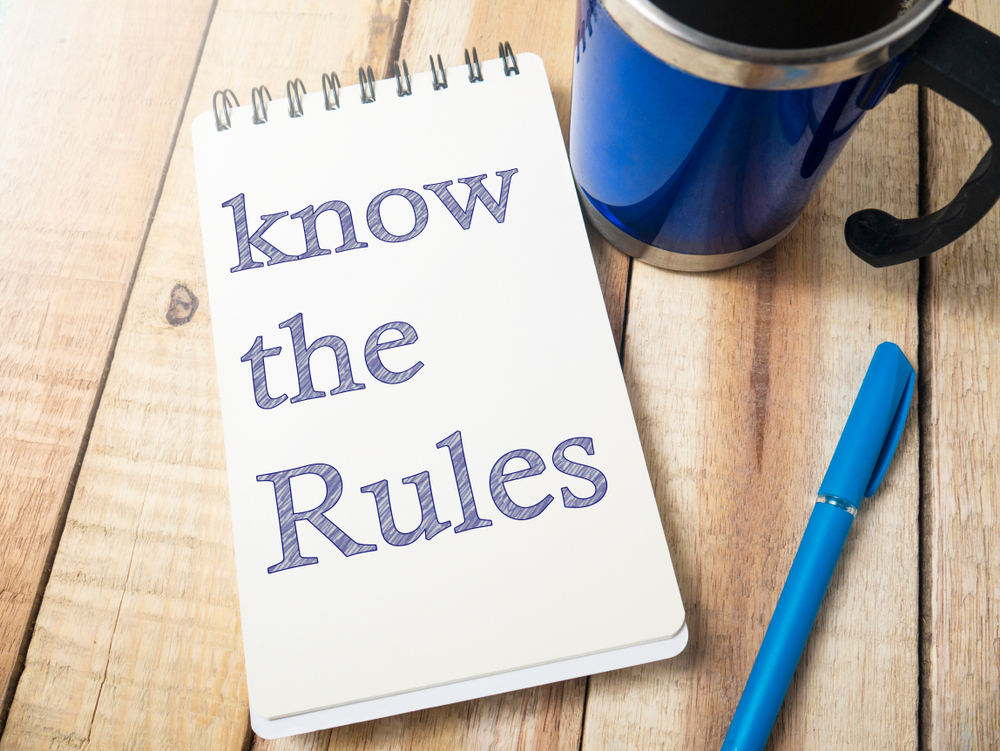 know the rules written on tablet next to pen and coffee cup