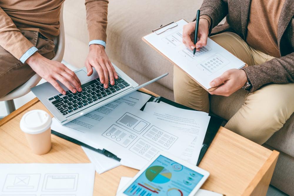two people preparing paperwork