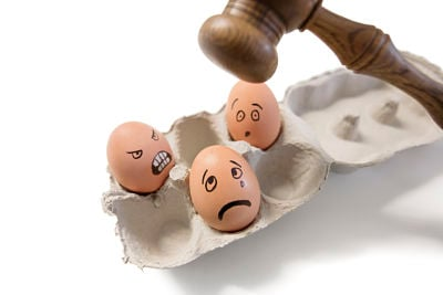 gavel hitting eggs with faces